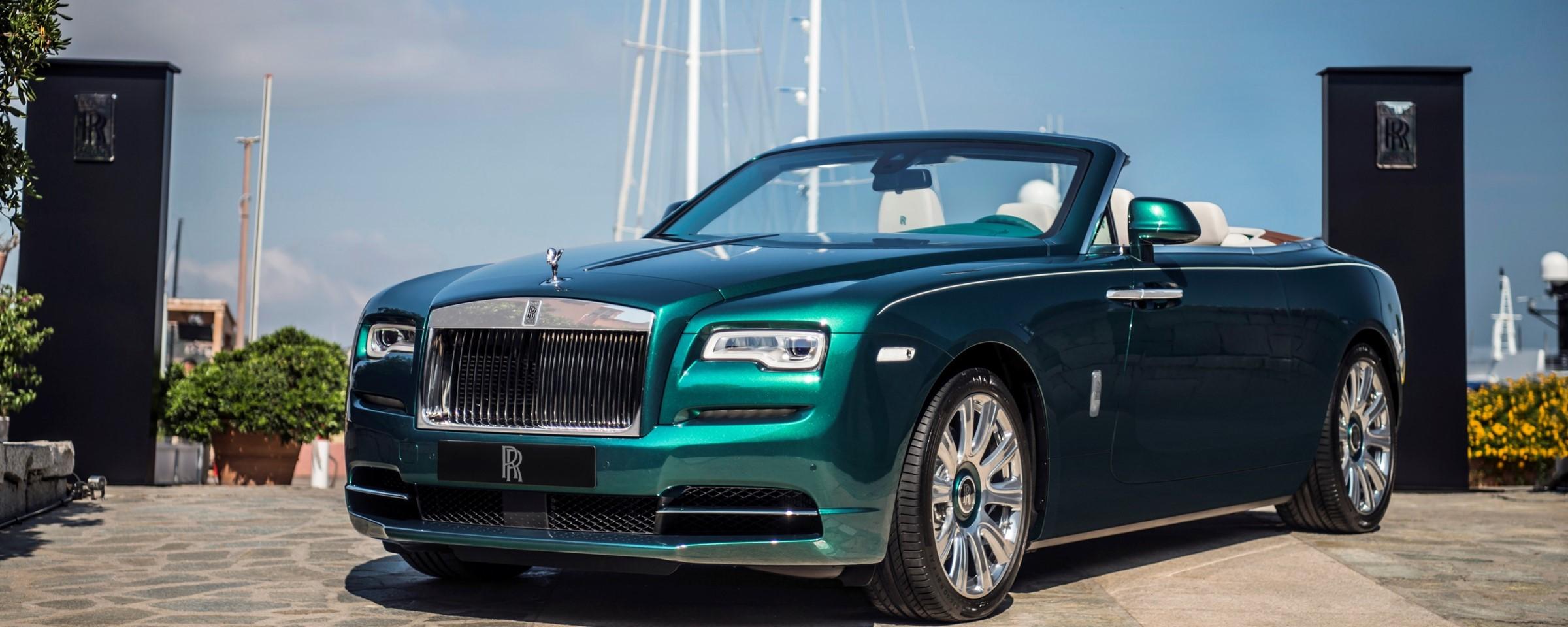 Rolls royce reveals emerald clad dawn rolls royce rancho for Rancho motors used cars